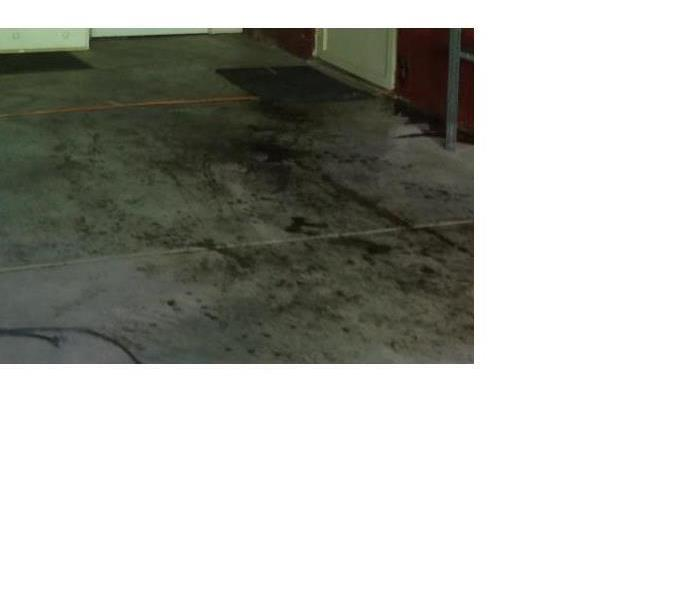 Garage Fire Flooring Damage  Before